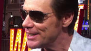 "Jim Carrey walked the red carpet at ""The Incredible Burt Wonderstone"" premiere Monday night wearing shiny silver boots, gold Elvis-style sunglasses and a white jacket. Hordes of screaming fans along Hollywood Boulevard in front of TCL Chinese Theater made his progress slow."