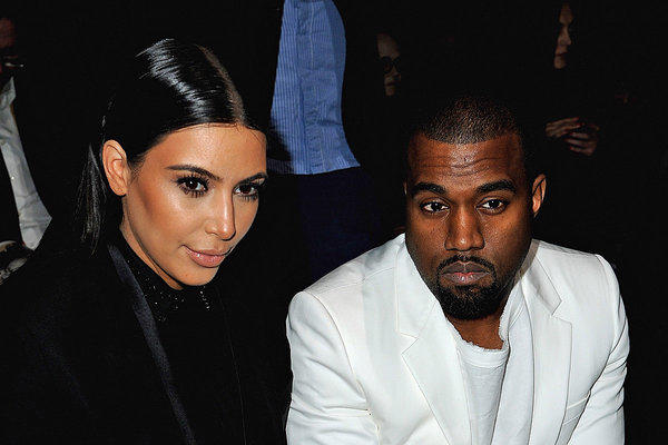 Kim Kardashian and Kanye West, shown earlier this month at Paris Fashion Week, are among the high-profile people whose personal and financial information has been hacked and posted online.