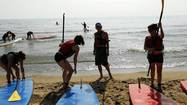 An increasingly popular watersport — stand-up paddle boarding — has grown big enough to make waves at Wilmette's designated sailing beach, where some say the mix of water craft grew dangerous last summer.