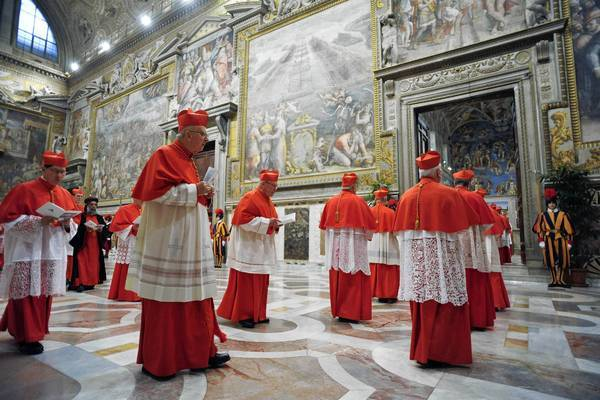 Cardinals enter the Sistine Chapel before the conclave begins.