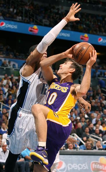 Orlando forward Tobias Harris (12) blocks a drive by Los Angeles guard Steve Nash (10) during the Los Angeles Lakers at Orlando Magic NBA game at the Amway Center in Orlando on Tuesday, March 12, 2013.  (Stephen M. Dowell/Orlando Sentinel)