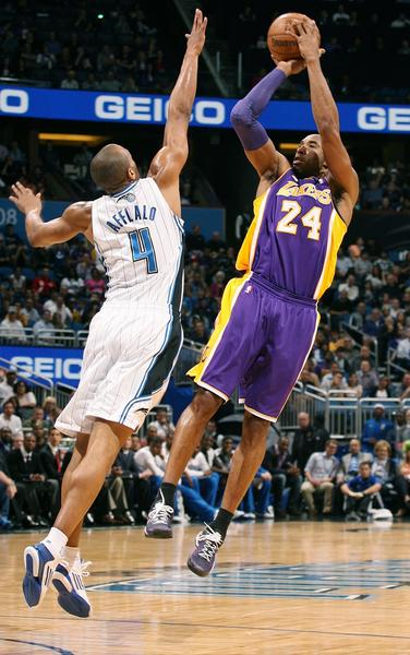 Los Angeles guard Kobe Bryant (24) shoots over Orlando guard Arron Afflalo (4) during the Los Angeles Lakers at Orlando Magic NBA game at the Amway Center in Orlando on Tuesday, March 12, 2013.  (Stephen M. Dowell/Orlando Sentinel)