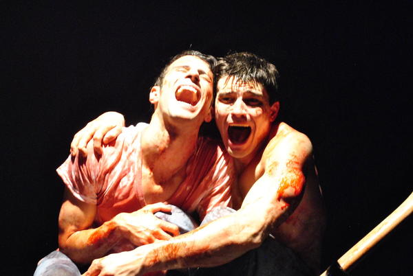 "Nathan Mohebbi, left, and Matthew Magnusson are in for a gory time in ""Wolves"" at the Celebration Theatre."