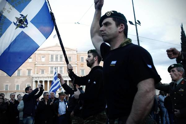 Military service members protest pension and salary cuts in Athens.