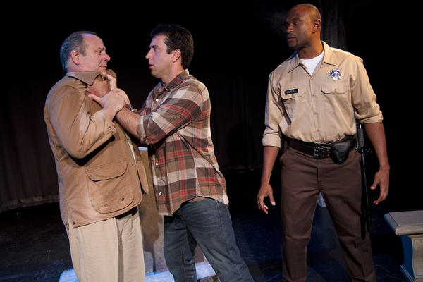 "A serial child predator (John Combs, left) faces his grown-up victims (Ashley McGee, center, and Will Blagrove) in ""Alabama Baggage."""