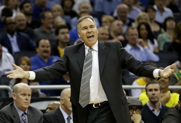 Lakers Coach Mike D'Antoni questions a call by an official.