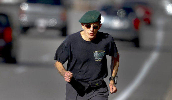 Wearing his signature beret from his days in the Special Forces, long distance runner John Creel trains on Birch Street in Brea. When Creel takes to the street this weekend in the LA Marathon it will be the 77-year-old Brea man's 60th marathon in all 50 states.