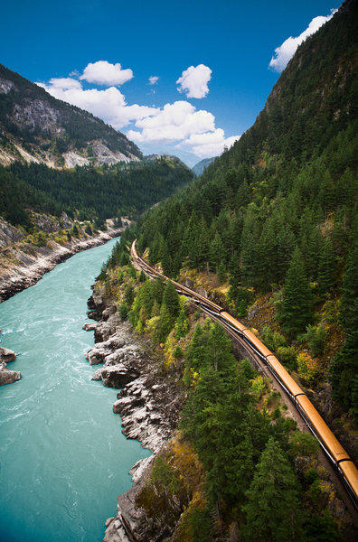 A luxurious passenger train snakes its way through scenic Fraser Canyon east of Vancouver.