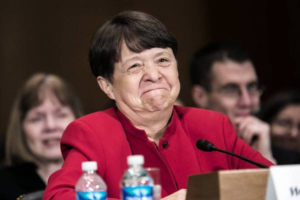 Mary Jo White testifies at a confirmation hearing before the Senate Banking committee.