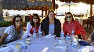 LOS CABOS, Mexico — Nonstop laughter resounded from the round table of nine seated in the corner of a fine-dining restaurant at an all-inclusive resort. To further pique my curiosity, each woman had a brightly colored silk flower pinned in her hair. I couldn't resist approaching them to find out their story.