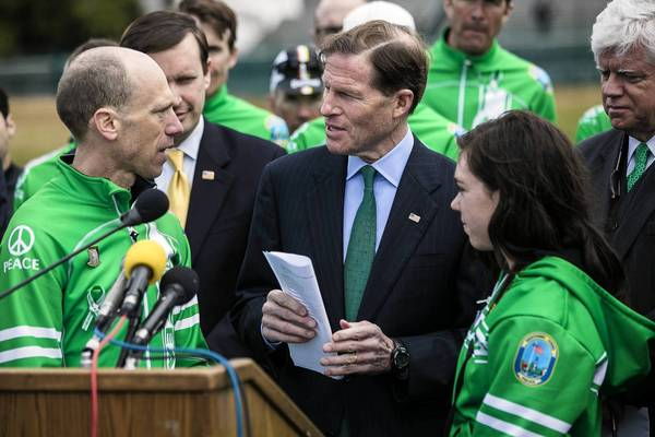 Monte Frank, left, of Newtown, Conn., gives Sen. Richard Blumenthal (D-Conn.) letters supporting gun control efforts in Congress.
