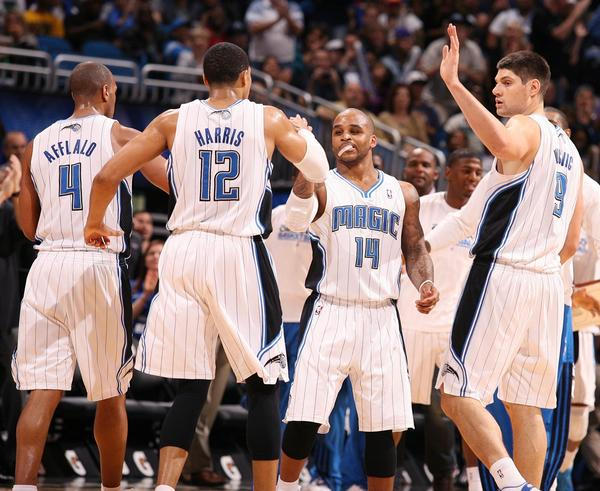 Orlando players celebrate after a run during the Los Angeles Lakers at Orlando Magic NBA game at the Amway Center in Orlando on Tuesday, March 12, 2013.  (Stephen M. Dowell/Orlando Sentinel)