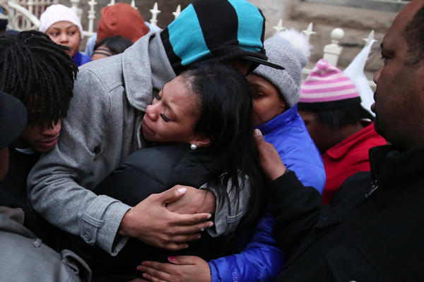 Judy Young, facing, the mother of 6-month-old Jonylah Watkins who died after being shot, is comforted after a press conference and vigil for the baby.