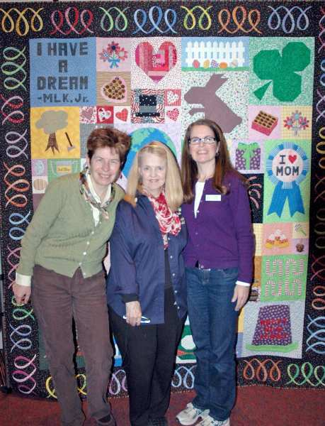 Glendale Quilt Guild members with the opportunity quilt, titled Holi-daze, that will be a prize at the Quilt Show on March 15, 16 and 17. Members are, from left, show co-chairwomen Beth Hasenauer and Caren Cooke Ryan and Tina Curran, who designed the opportunity quilt.