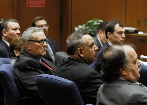 The six former Bell City Council members -- George Mirabal, top, Luis Artiga, Teresa Jacobo, George Cole, Oscar Hernandez and Victor Bello -- are shown at the start of their trial in L.A. County Superior Court in January.