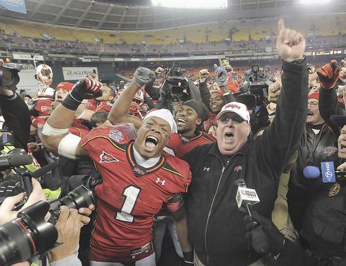 Senior linebacker Adrian Moten and Terps coach Ralph Friedgen celebrate Maryland's 51-20 win over East Carolina in the Military Bowl.