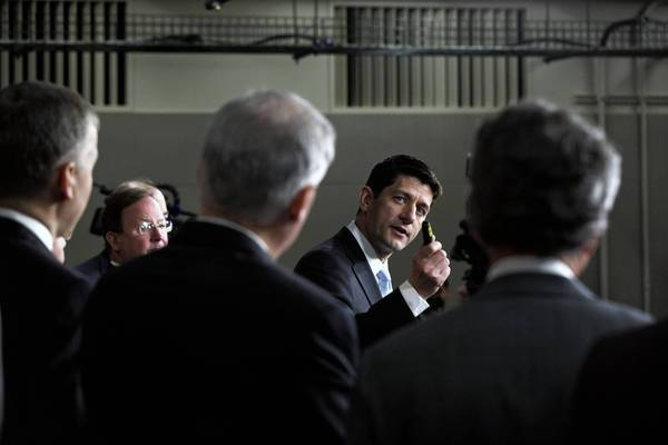 House Budget Committee Chairman Rep. Paul D. Ryan (R-Wis.), in back, unveils the GOP budget proposal.