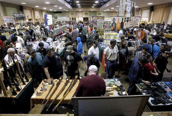 People gather for what may be the last gun show at the Glendale Civic on March 2, 2013.