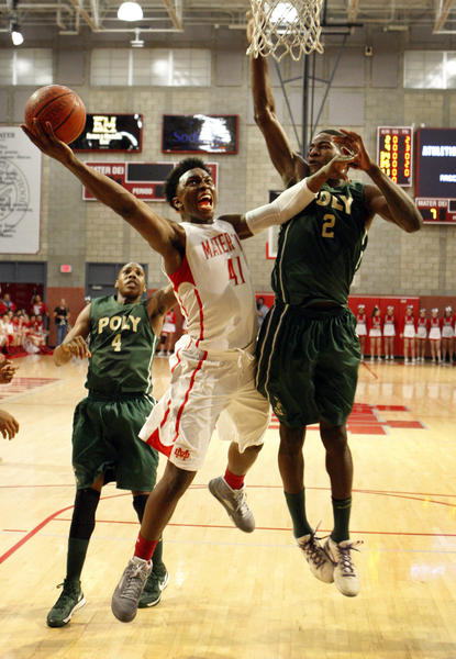 Long Beach Poly's Chris Sullivan, left, and Jordan Bell, right, battle Mater Dei's Stanley Johnson as he drives to the hoop for a basket in the first half of the CIF Southern California Open Division semifinal basketball playoff game at Mater Dei High School Tuesday, March 12, 2013. Mater Dei won 83-63. (Allen J. Schaben/Los Angeles Times)