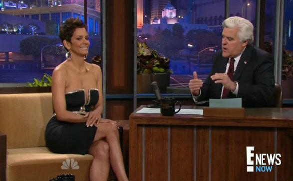 "Halle Berry in a Reem Acra dress talks with Jay Leno on ""The Tonight Show."""