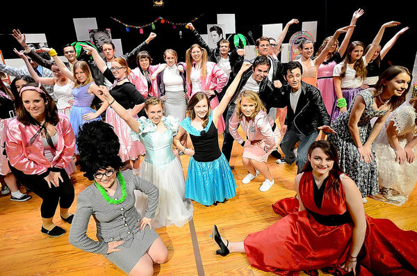 """The student cast of """"Grease"""" performs during Tuesday's dress rehearsal at Greencastle-Antrim High School. G-AHS will present """"Grease"""" at the high school Friday and Saturday at 7:30 p.m. and Sunday at 3 p.m. Tickets cost $5 and will be sold at the door. Doors open to the public at 6:45 p.m. on Friday and Saturday at 2:15 p.m. on Sunday."""