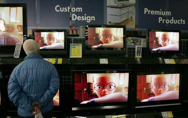 A customer shops for flat-panel televisions at a Best Buy in San Francisco.