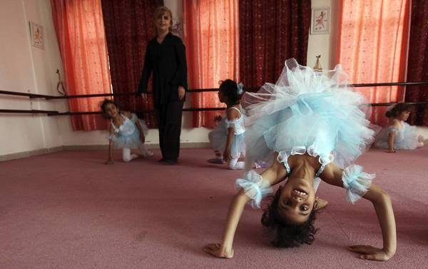 Girls attend their first ballet class at studio Cinderella in Sanaa March 12, 2013.