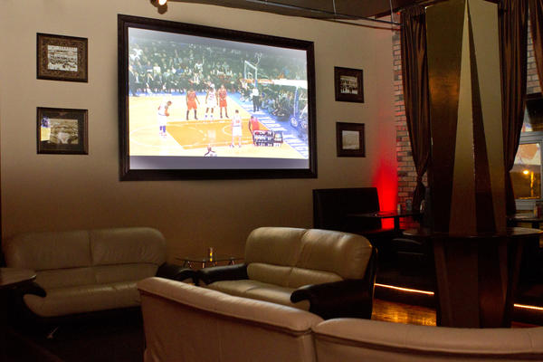 "<i>2529 N. Milwaukee Ave. 773-360-7478</i><br> <b>Basketball affiliation:</b> None<br> <b>The digit:</b> Two. Suite 25 is located on the second floor, so look carefully for its door at street level.<br><br> What do dim lights, DJ beats and a Mike Ditka mural have in common? They're all in the mix at this self-proclaimed ""ultra sports lounge,"" in Logan Square that combines elements of a sports bar -- an 80-inch projection screen, chicken wings -- with lounge touches such as leather couches and a neon lava-top bar. South American-inspired snacks such as the croquette-like Incan tater tots ($8) and beef empanadas ($8) are a departure from standard bar food. Specials include 25-cent wings from 5-7 p.m. weekdays and $5 Absolut cocktails on Thursdays."