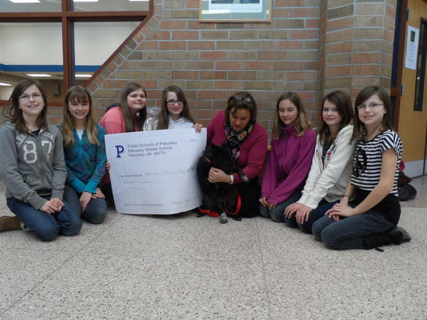 Sixth-grade girls from Petoskey Middle School present a check for $391 to Teresa Chaney, events coordinator at the Little Traverse Bay Humane Society and Sheba, a 6-month-old Australian cattle dog up for adoption. Pictured (from left) are Kenzie Haas, Emma Decker, Shannon Graves, Marlee Tache, Teresa Chaney with Sheba, Kayla Decker, Olivia Nolff and Korrie Haas.