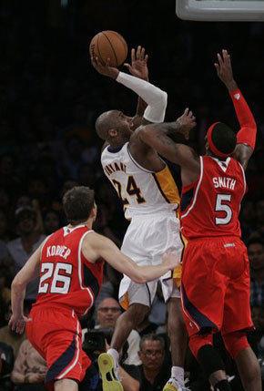 Lakers guard Kobe Bryant shoots over Atlanta forward Josh Smith.