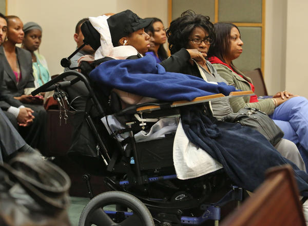 Danielle Sampson sits in a wheelchair in the trial of Tyrone Mosby who is accused of shooting Sampson as she was a passenger in a family vehicle.