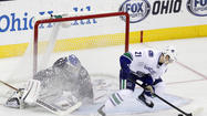 Vancouver Canucks' Raymond scores goal on Columbus Blue Jackets' Bobrovsky during overtime shootout period of their NHL hockey game in Columbus
