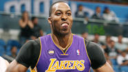 "Lakers center Dwight Howard was ""hacked"" by Orlando Magic players over and over Tuesday night, and he made them pay by making 16 of 20 free throws when intentionally fouled."