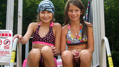 Maria Tinkey, left, and her sister, Sarah, Somerset, at their swimming pool that Maria received through the Make A Wish Foundation of Greater Pennsylvania and Southern West Virginia.