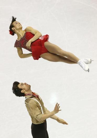 Airborne: Canada's Meagan Duhamel soars after partner Eric Radford launched her on a triple twist.  (Tom Szczerbowski-USA TODAY Sports)