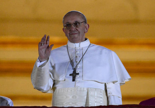 Newly elected Pope Francis, Cardinal Jorge Mario Bergoglio of Argentina appears on the balcony of St. Peter's Basilica after being elected by the conclave of cardinals, at the Vatican, March 13, 2013.