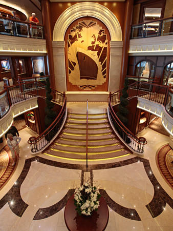 The ornate lobby is the main entrance to the ship, which carries about 2,000 passengers and 1,000 crew members. The lobby is three decks high and linked with staircases.