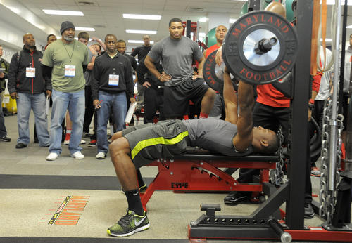Kenneth Tate tries to impress the scouts during his bench press in the weight room at the Gossett Football Team House.