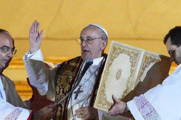 Argentina's Jorge Bergoglio, elected Pope Francis I, blesses members of the crowd gathered at the Vatican after being elected the 266th pope of the Roman Catholic Church on Wednesday.