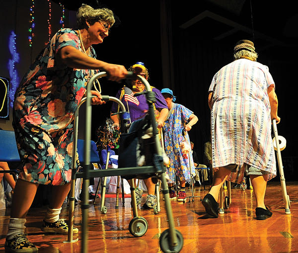 Betty Smith dances with her walker in a revue at Clear Spring High School Sunday afternoon. The musical skit involved Smith, Kathy Miles, Denise Binkley, Cherry Snyder, and Esther Whitley doing a spoof of a well-known music video. The Clear Spring Lions Club put on its' 60th annual minstrel show.