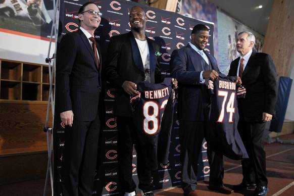 Tight end Martellus Bennett (second from left) and offensive tackle Jermon Bushrod (second from right) pose with head coach Marc Trestman (left) and general manager Phil Emery (right).