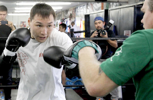 Ruslan Provodnikov works out with trainer Freddie Roach on Friday.