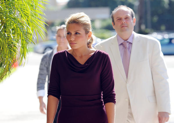 In this photograph, Vivian Marks and her father Ricky Marks arrive at federal court in West Palm Beach for a hearing. Both have since pleaded guilty to fraud-related charges. Mark Randall, South Florida Sun Sentinel
