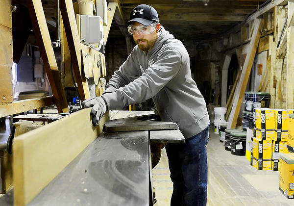 Tim Kline uses a jointer on a piece of wood at Miller Lumber Co. in Williamsport on Monday.