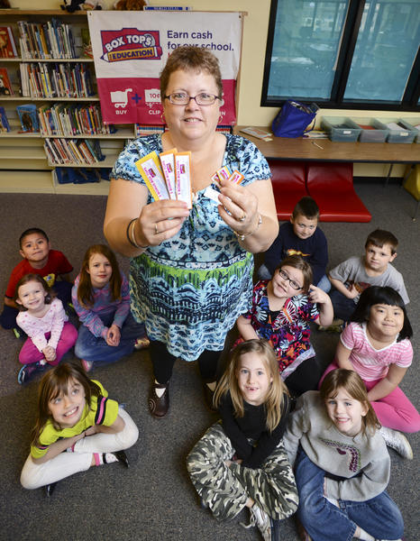 Gail Vaughn, fundraising coordinator for the Box Tops for Education program at Lincolnshire Elementary School in Halfway is surrounded by students who benefit from the program