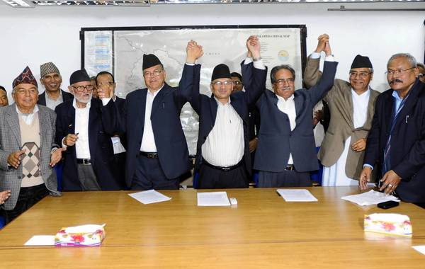 Nepalese Prime Minister Baburam Bhattarai , center right, and leaders of political parties celebrate after signing an agrement in Kathmandu, the capital. The prime minister is to step down, with the Supreme Court chief justice taking his place until an election is held.