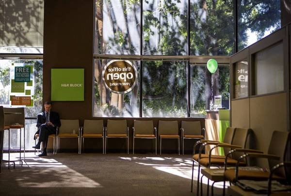 A filing blunder by H&R Block and other tax preparers affects customers — mainly students — who filed Form 8863 for education credits. Above, a man waits in the lobby of an H&R Block office in Los Angeles last month.