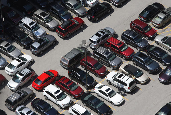 Cars are seen in a Loop parking lot. Mayor Rahm Emanuel wants to change city taxes for parking in a Chicago lot or garage.