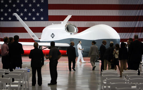 Officials look on after Northrop Grumman Corp. unveiled a drone aircraft for the Navy in Palmdale.