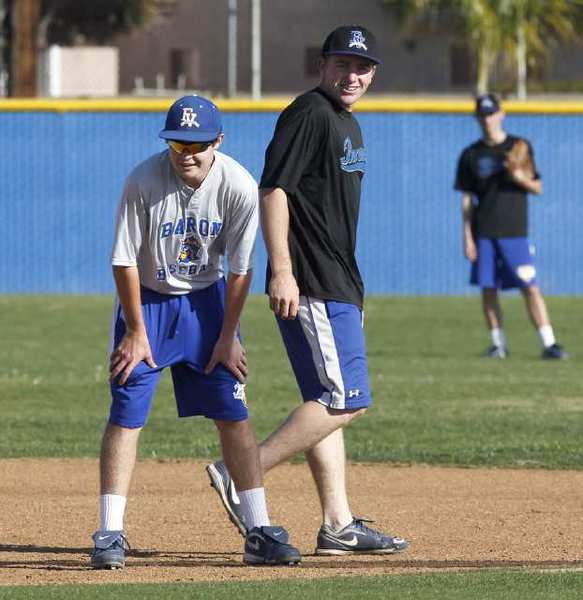 Fountain Valley's Dillon Persinger, left, and John Shattles, run bases during practice Tuesday.